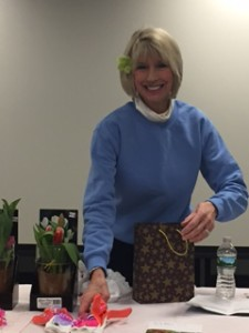 Eileen Avia, president of the Wyckoff Area Garden Club prepares to give out prizes from the day's drawing. Three luck winners received gardening gloves and hand cream; two others received lovely tulip plants.